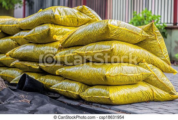 Bags with garden bark - csp18631954