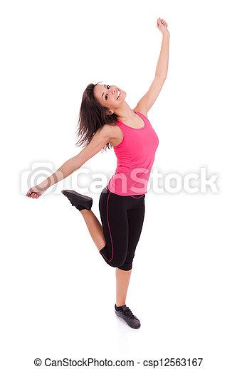 Una joven y hermosa mujer caucásica bailando - csp12563167