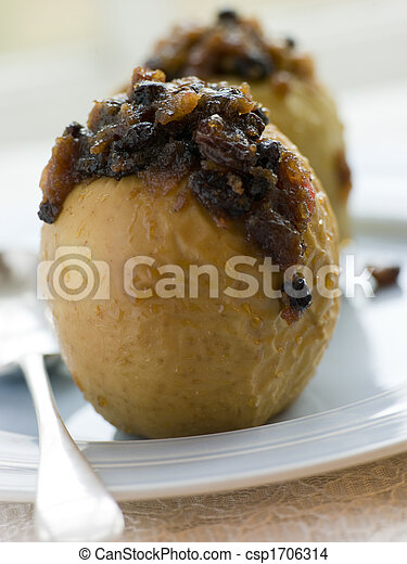 Baked Apples stuffed with Christmas Pudding - csp1706314