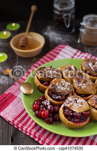 Baked apples with cranberries - csp41074530