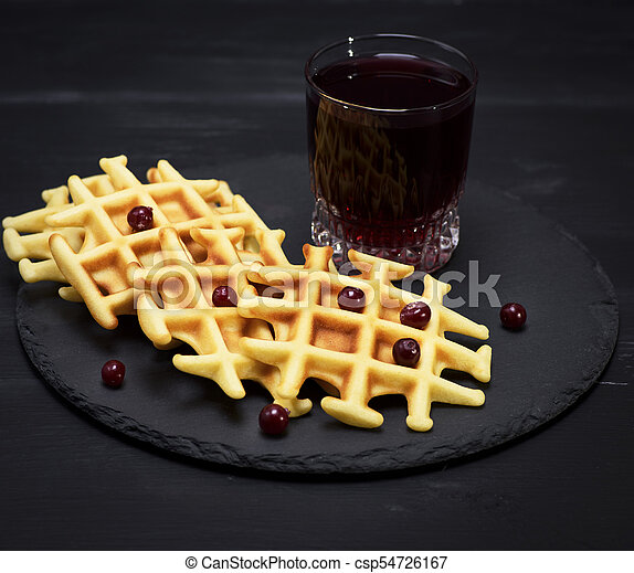 baked Belgian waffles and fruit compote - csp54726167