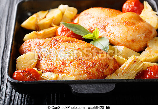 Baked chicken fillet with artichokes and tomatoes closeup. horizontal - csp56420155