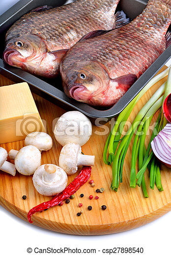 Baked fish with vegetables, sauce, - csp27898540