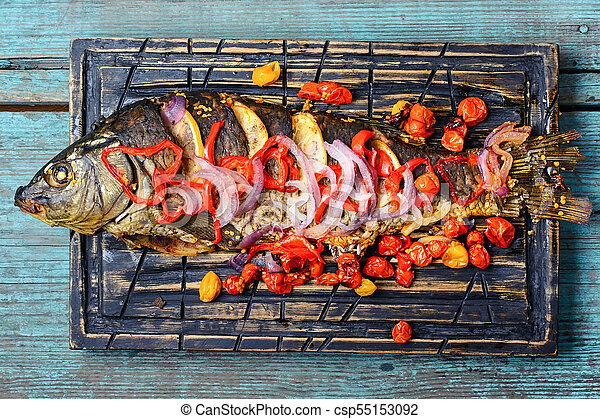 Baked fish with vegetables - csp55153092