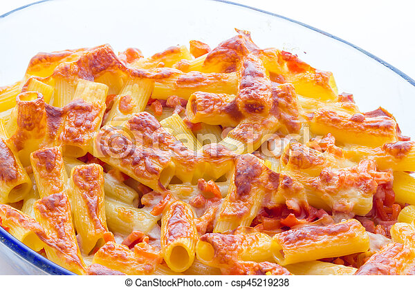 Baked macaroni cheese with tomatoes and sausage - csp45219238
