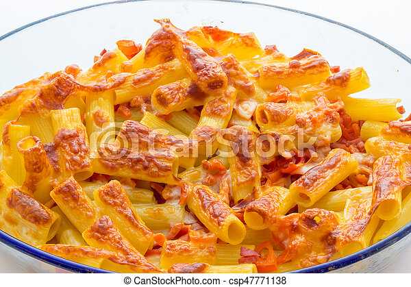 Baked macaroni cheese with tomatoes and sausage - csp47771138