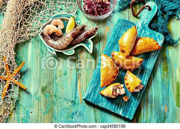 Baked Seafood Empanadas with Fresh Ingredients - csp34580199