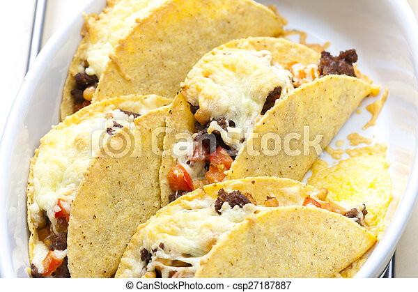 baked tacos filled with minced beef meat, beans and tomatoes - csp27187887