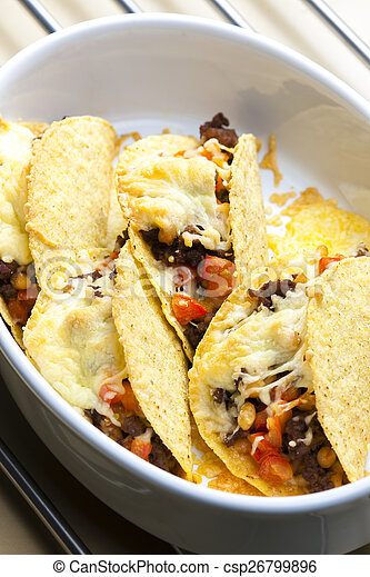 baked tacos filled with minced beef meat, beans and tomatoes - csp26799896
