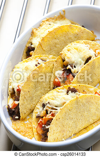 baked tacos filled with minced beef meat, beans and tomatoes - csp26014133