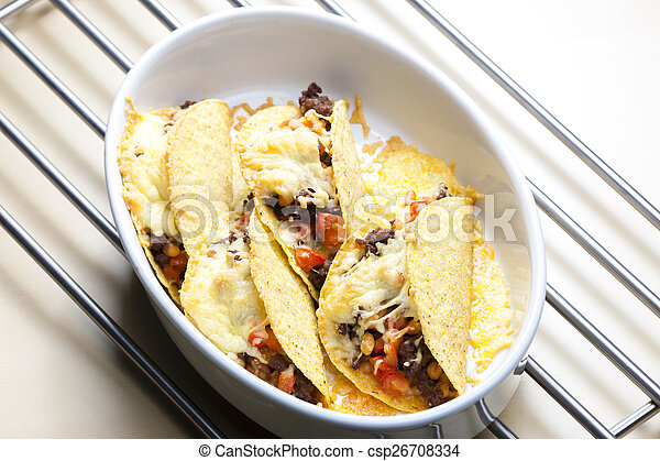 baked tacos filled with minced beef meat, beans and tomatoes - csp26708334
