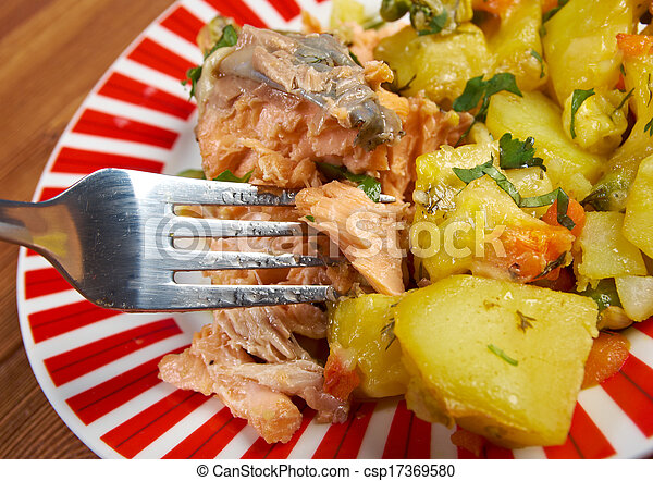 Baked trout with potatoes - csp17369580