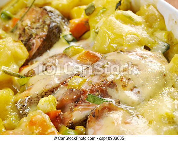 Baked trout with potatoes - csp18903085