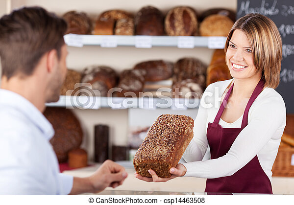 Bakery assistant selling bread - csp14463508