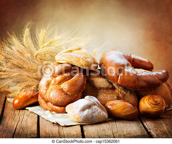Bakery Bread on a Wooden Table. Various Bread and Sheaf - csp15362061