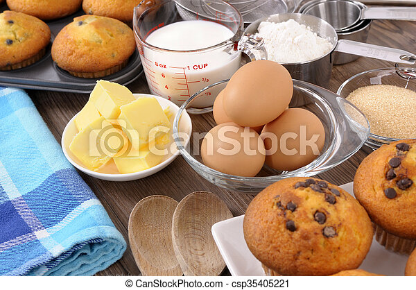 Baking ingredients with fresh muffins - csp35405221
