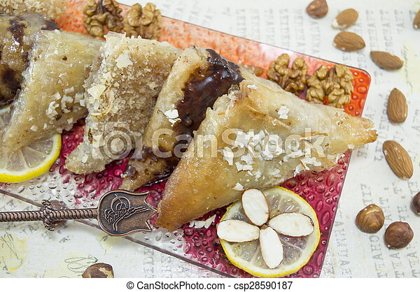 Baklava decorated with nuts, lemon and almonds - csp28590187