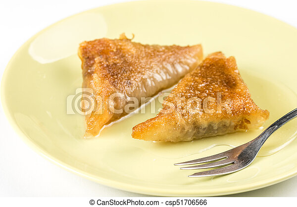 Baklava pie with walnuts on the plate - csp51706566