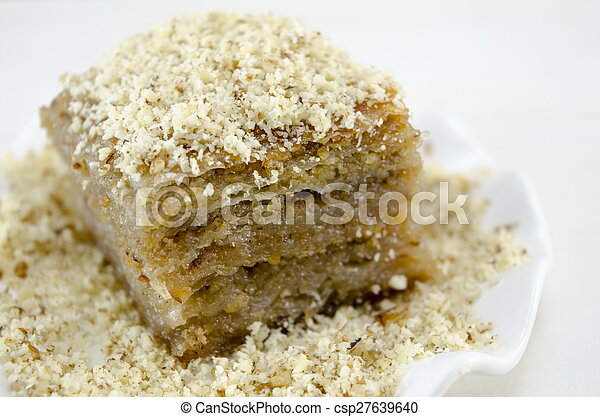 Baklava with grated walnuts on a plate - csp27639640