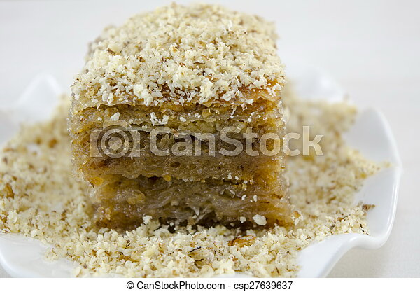 Baklava with grated walnuts on a plate - csp27639637