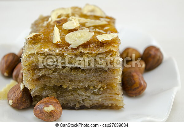 Baklava with hazelnuts on a plate - csp27639634
