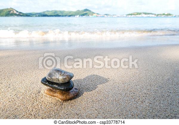 Balance stone on the beach - csp33778714