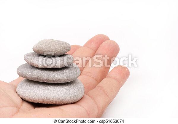 Balanced grey stones in hand - csp51853074