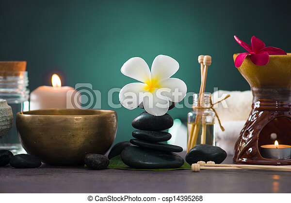 Balanced spa stones with green leaves background. - csp14395268