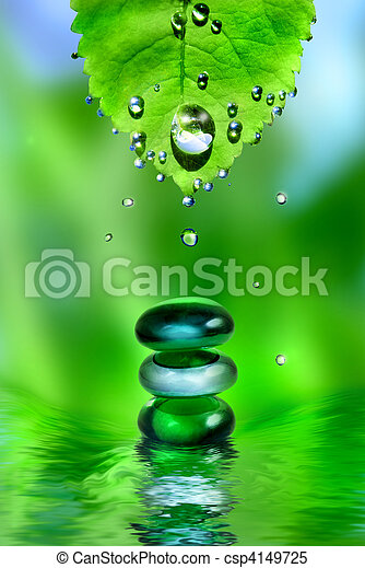 balancing spa shiny stones with leaf and water drops on green background - csp4149725