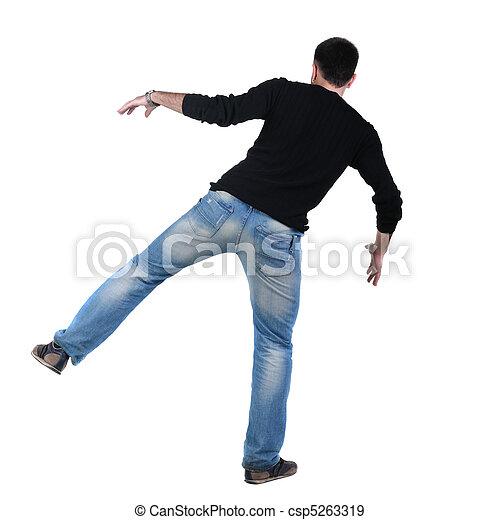 Balancing young man in jacket. Rear view. - csp5263319