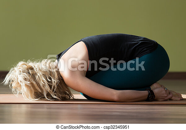 balasana yoga pose sporty beautiful blond young woman in