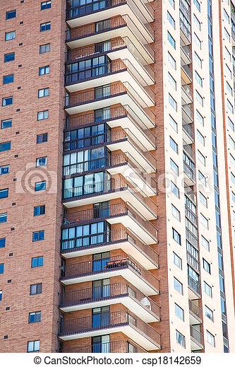 Balconies On Modern Brick High Rise   Csp18142659