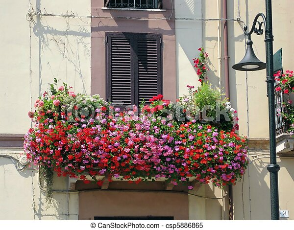 balcony drowned in flowers balcony in a small italian town