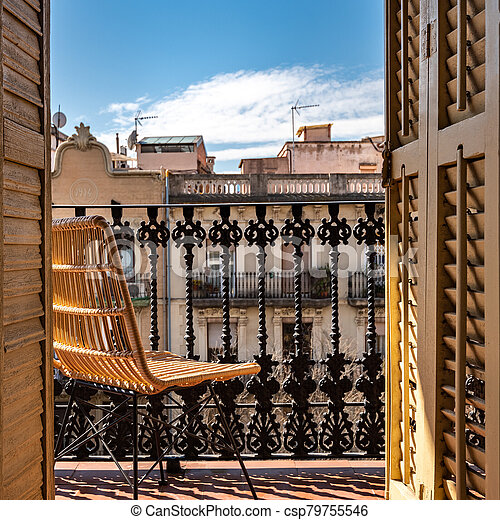 Balcony With A Wrought Iron Railing Wooden Sashes And Wicker Chair Sunny Day Blue Sky Barcelona Spain Canstock