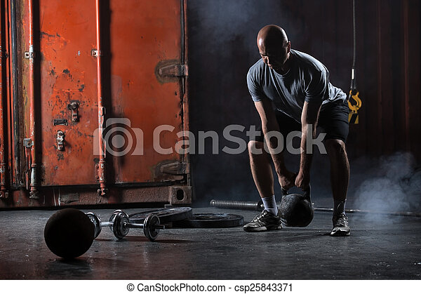 Bald charismatic athlete doing squats with weights. - csp25843371