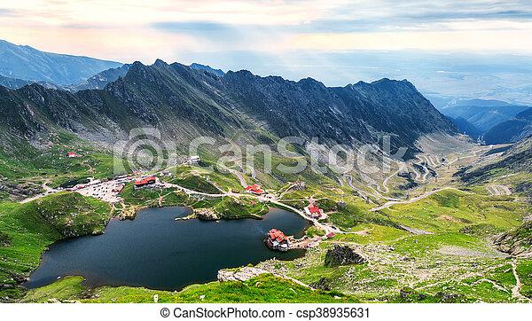 Balea Lake, seen from above. Glacial lake, on Transfagarasan highway in Carpathian mountains, Romania in summer - csp38935631