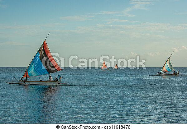 Balinese Jukung fishermen - csp11618476