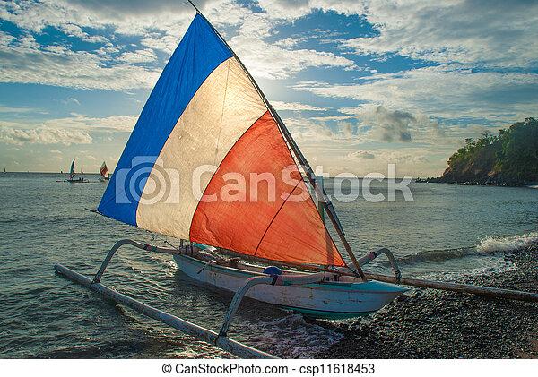 Balinese Jukung fishermen - csp11618453