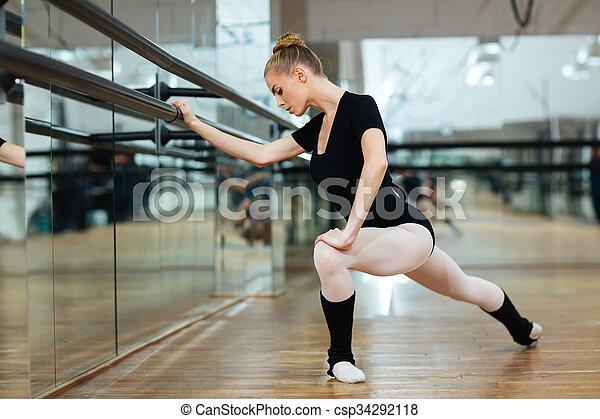 ballerina doing stretching exercises beautiful ballerina