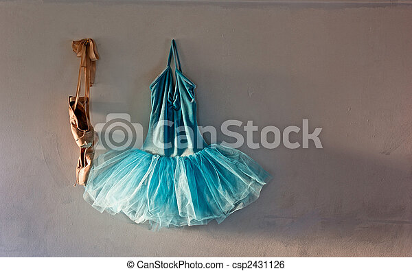 4489bbf22f8c Ballet costume on old wall. A blue velvet romantic tutu is hanging ...