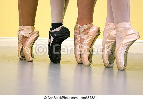ballet dancers feet in pointe shoes - csp6678211