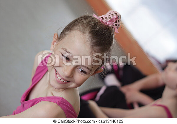 Ballet girl with friends during ballet lesson - csp13446123