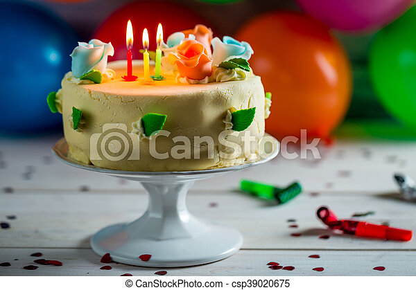 Balloons And Birthday Cake With Candles For A Party