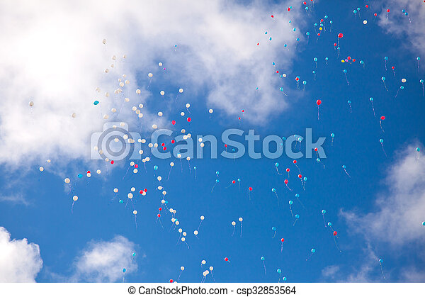 balloons in the sky with clouds - csp32853564