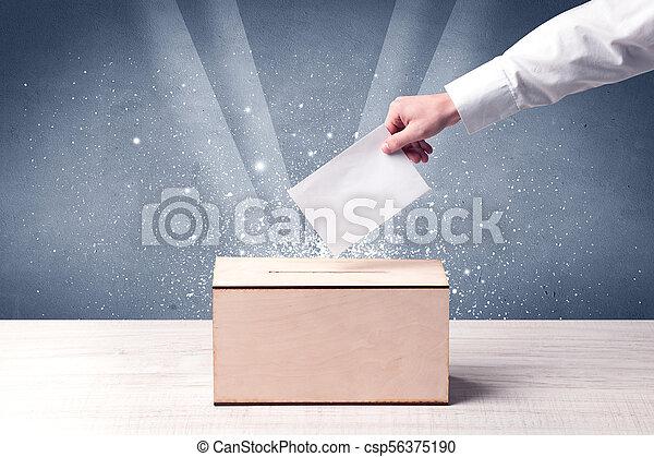 Ballot box with person casting vote - csp56375190