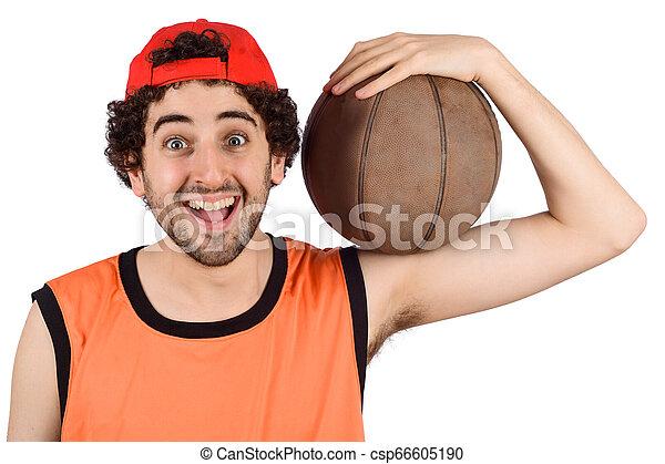 Un joven con pelota de baloncesto. - csp66605190