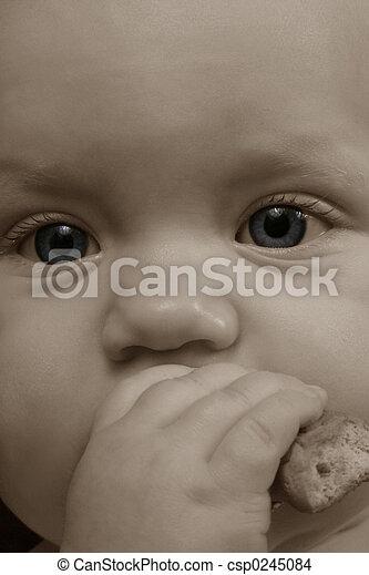 bambino mangiando - csp0245084