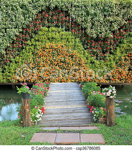Bamboo Bridge With Vertical Flower Garden   Csp36786085