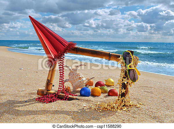 bamboo frame with christmas decorations on the beach csp11588290
