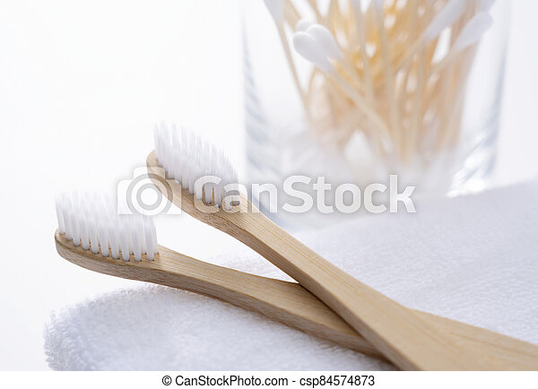 Bamboo toothbrush and bamboo cotton swabs - csp84574873